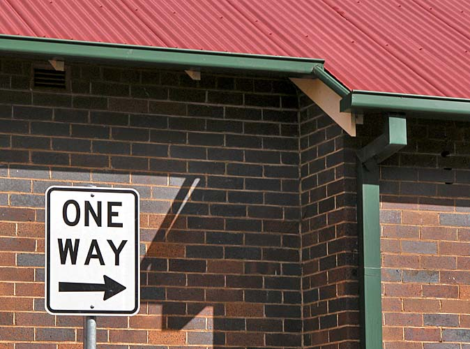 One way sign / wall / roof