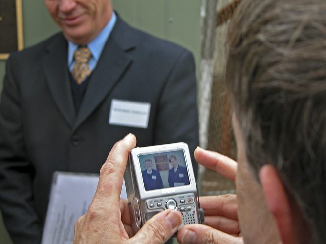 Photograph of photographer reviewing photograph