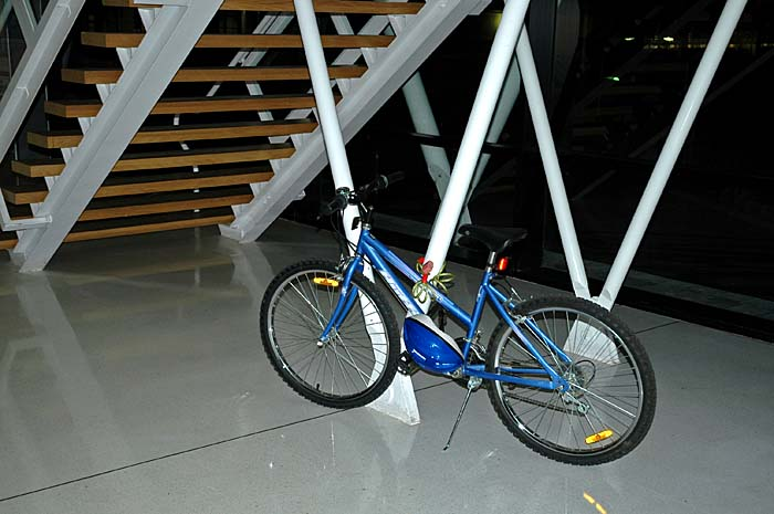 Photo of bike under stairs with flash
