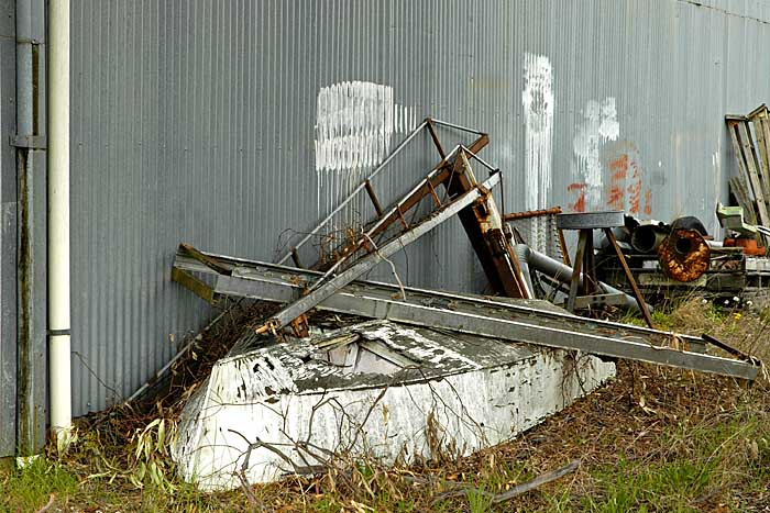 Upturned boat outside the building