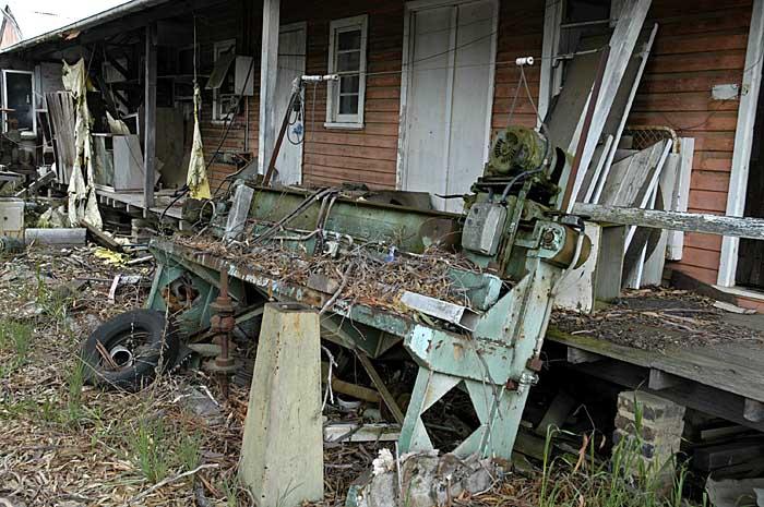 The verandah has discarded junk around it