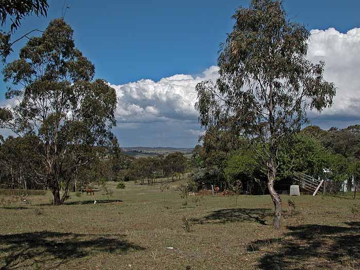 Clouds over rural landscape