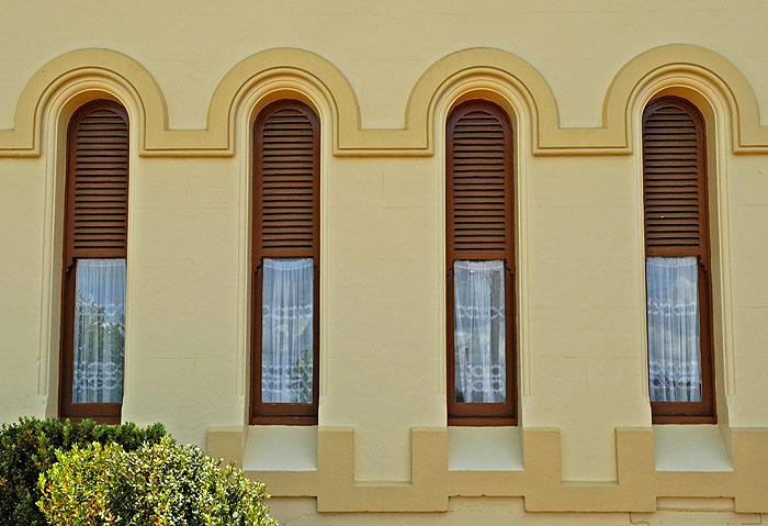 Four narrow vertical windows outside railway station