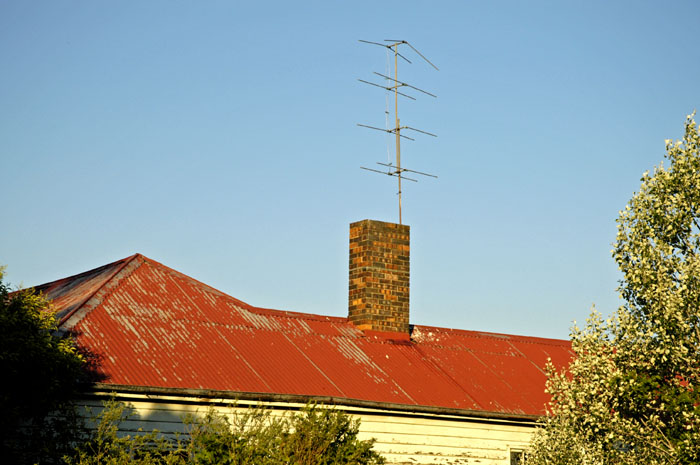 Old TV antennas on old farmhouse roof
