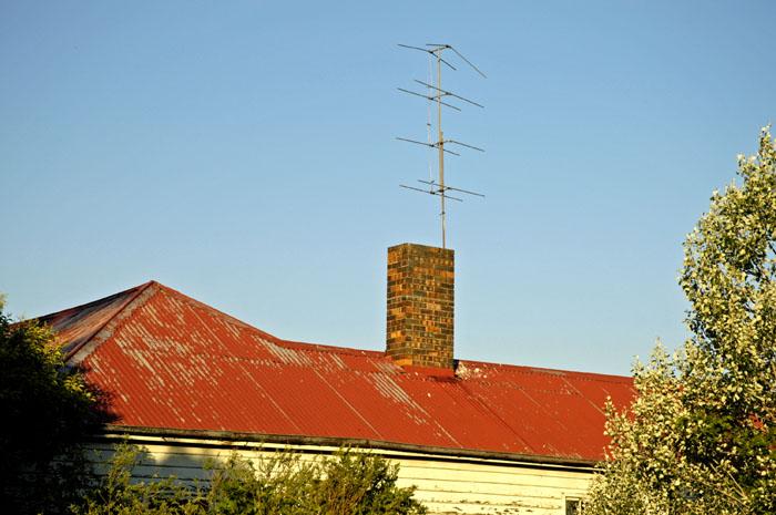 Old TV antennas on old farmhouse roof