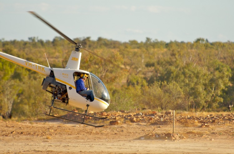 Helicopter taking off at Innamincka